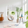 01-Airy-living-room-is-full-of-light-and-greenery-that-binds-it-with-outdoors