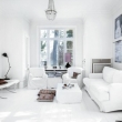 all-white-living-room-with-ethnic-style-cushions