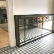 art-deco-circles-mirrored-radiator-cover-with-tiled-floors-black-and-white-checked-small