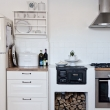 Scandinavian-kitchen-with-small-wood-burning-stove